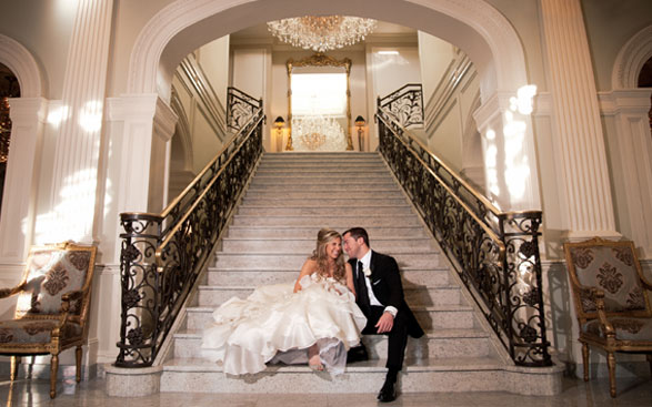Bride and Groom relax on the Grand Staircase at Rockleigh Country Club