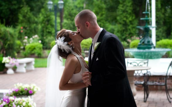 Bride and Groom steal a kiss in our luxurious gardens in Northern NJ